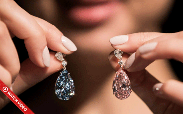 Two different coloured earrings have sold for more than US$57 million, setting an auction record. Image courtesy: Sotheby's