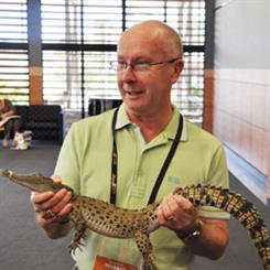 JAA President Peter Beever with a baby croc at Nationwide's annual conference