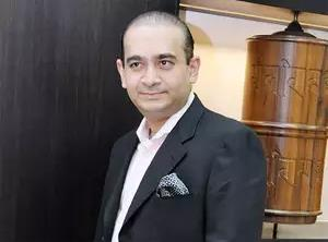 "Nirav Modi, billionaire jeweller under investigation. Image courtesy: <a href=""https://economictimes.indiatimes.com/industry/banking/finance/banking/assure-fair-trial-for-nirav-modi-counsel/articleshow/63104253.cms"" target=""_blank"">The Economic Times</a>"