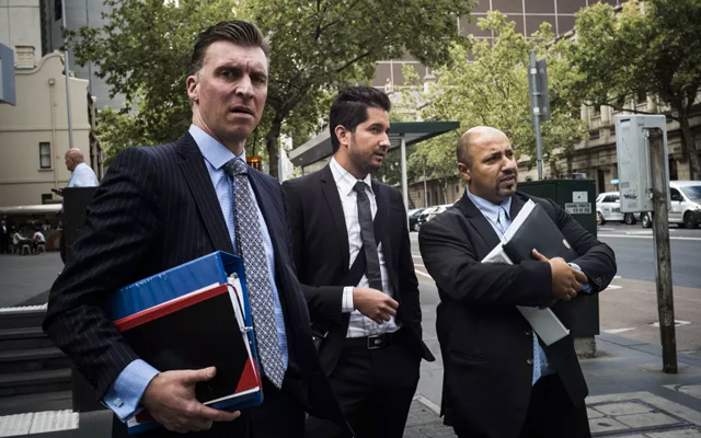 Alejandro Mendieta Blanco (centre, pictured in 2018) has pleaded guilty to a single count of receiving stolen goods. Image credit: The Age