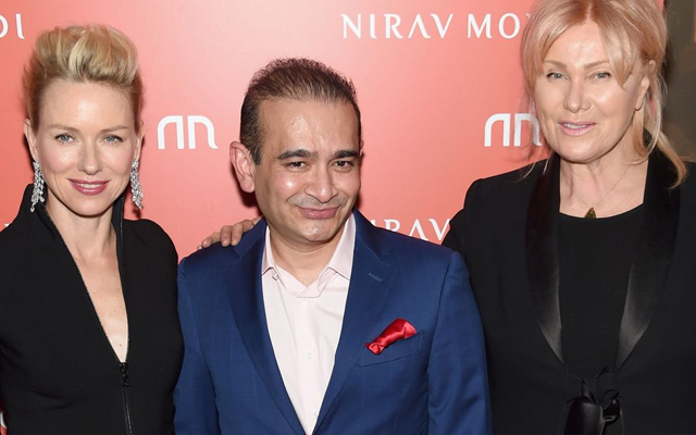 Nirav Modi (centre) has officially been charged after being linked to a billionaire bank fraud. Image courtesy: Sky News