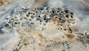 Taken from drone footage this shot clearly shows the numerous pits seen in the mining areas. Image courtesy Wim Vertriest/GIA