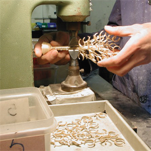 A team member removing pieces from a cast tree