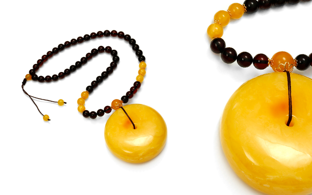 The Amber Centre's antique and cherry amber necklace with gold detail