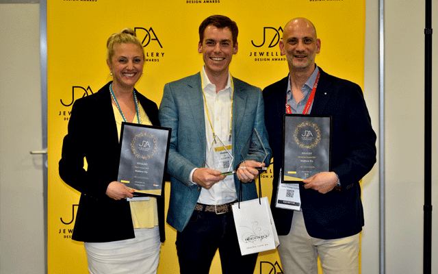 Young jeweller Matthew Ely (centre) won the Opal Award, presented by Ikecho's Erica Miller (left), and the Diamond Award, presented by Steve der Bedrossian of SAMS Group Australia (right). Image credit: Orlando Sydney Event Photography