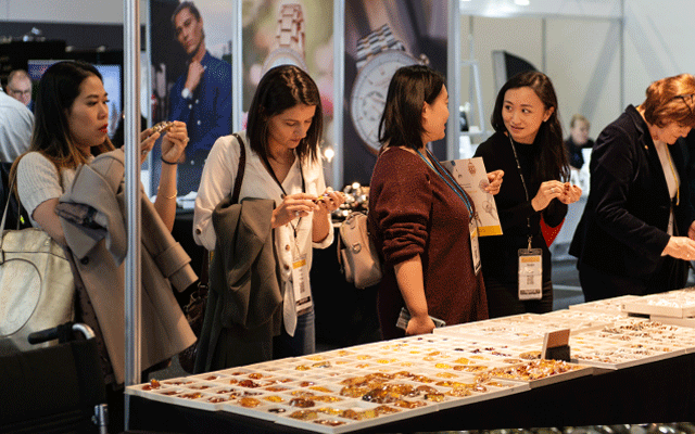 Retailers peruse the selection of product on offer.