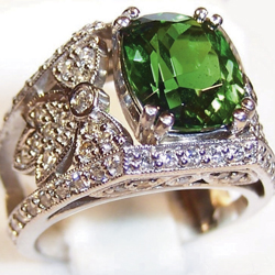 A ring featuring a 3-carat Tsavorite set in platinum with pavé diamonds.