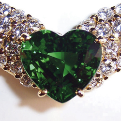 A pendant set with a 3.5-carat Tsavorite heart set in 18 carat gold, and pavé diamonds.