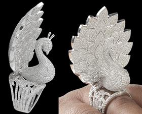 This Peacock Ring weighs 50.42 g in total and the diamonds used in the ring have a combined carat weight of 16.5.