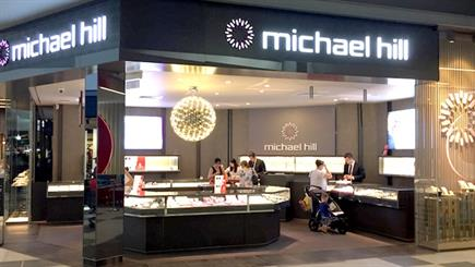 A retail employee at a Michael Hill store claims she was pressured not to speak out about an alleged workplace assault, under penalty of breaching her employment agreement.