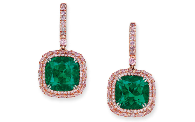 A one-of-a-kind pair of emerald earrings also broke records, fetching a final price of $US2.05 million. Image credit: Christie