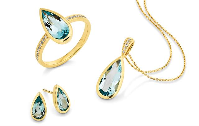 Yellow gold ring and matching earrings and pendant set with diamonds and London Blue topaz.