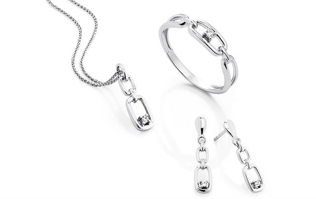 White gold pendant, ring and earrings set with diamonds.