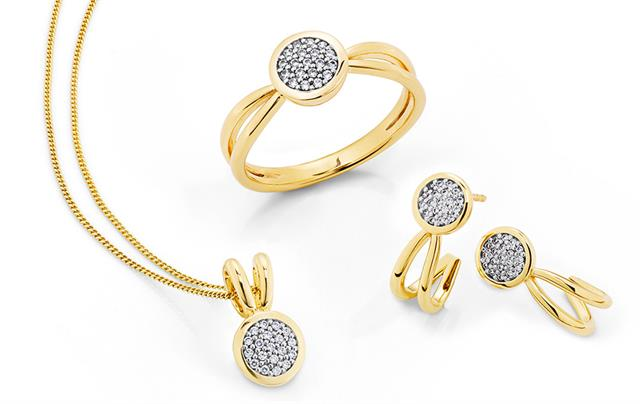 Yellow gold ring with matching earrings and pendant set with diamonds.