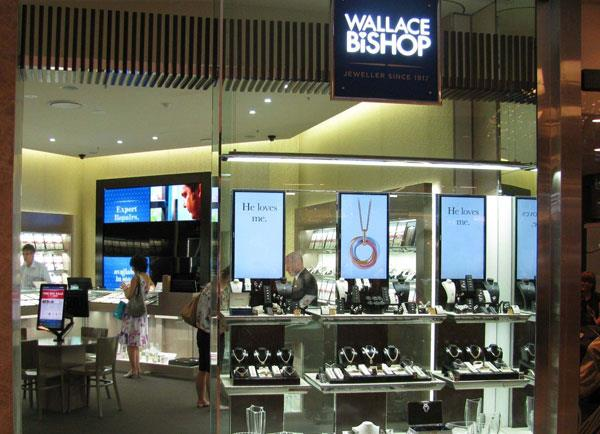 Large digital screens illuminate the front windows to draw attraction from passing customers.