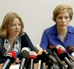 Spokeswomen for the prosecutor Anja Bijnens and Ine Van Wijmersch talk to the press.