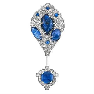 Cartier platinum, carved sapphire, diamond jabot, 1925