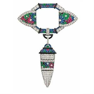 Van Cleef & Arpels platinum, millegrain-set mount, brilliant-cut diamonds, rubies, tallow-cut sapphires, emeralds and enamel 1924