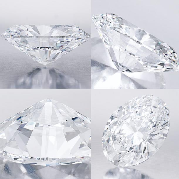 The unmounted oval brilliant-cut diamond, weighing 118.28 carats, is shown in different angles