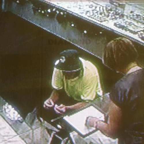 CCTV footage shows Watts dressed as a construction worker with store manager Liljana McDonald. Source: News Limited