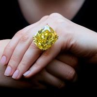 Two world records were broken at once with the sale of the Graff Vivid Yellow ring for $17.4 million