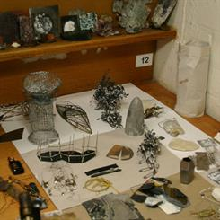 Inari Kiuru's work bench with material samples and developing work.