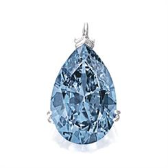 A 9.75-carat fancy vivid blue diamond set two new world auction records