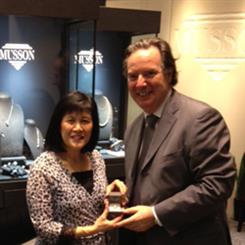 Sandra Fong receives her prize, the elegant 'Sun Struck diamond ring from Robert Musson, owner of Musson Jewellers