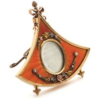 A gold and enamel miniature frame by Carl Fabergé, circa 1900