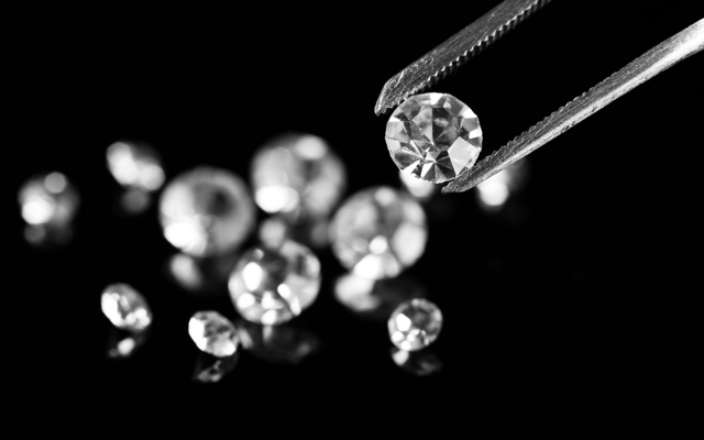 Ten diamond traders are believed to have been involved in a grading report alteration scheme