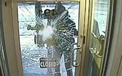 Security footage showing three men attempting to smash the front door of a Sydney Road jewellery store. Source: 7 News