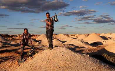 "Daniel Becker, left, and Justin Lang in the opal fields outside Coober Pedy. Image courtesy: <a href=""http://www.theaustralian.com.au/news/nation/gem-next-in-grip-of-sparkle-fever-and-they-dig-it/news-story/7b4d511b7ebd3daea4e50c79e822333d?login=1"" target=""_blank"">The Australian</a>, Kelly Barnes"