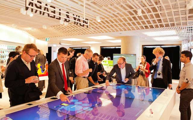 Customers browse at a Telstra store. Image courtesy: Retail Doctor Group