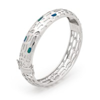 The newest development of Opal Australia's famous sterling silver inlay opal collection. The adventurous bangle design shatters the popular belief that Opal jewellery are dull and old fashioned.